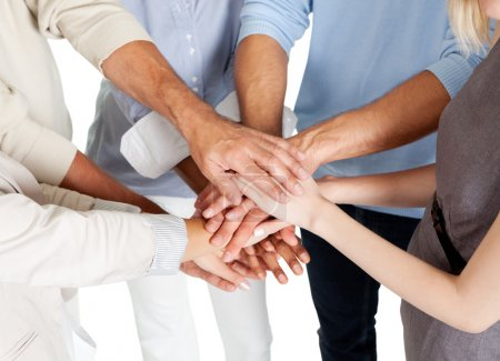 Photo for Closeup of a business colleagues with their hands stacked together - Royalty Free Image