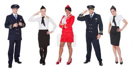Photo pour Membres d'équipage de vol, les pilotes, les hôtesses de l'air. isolé sur blanc - image libre de droit