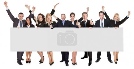 Photo for Group of excited business presenting empty banner. Isolated on white - Royalty Free Image