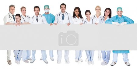 Group of doctors presenting empty banner