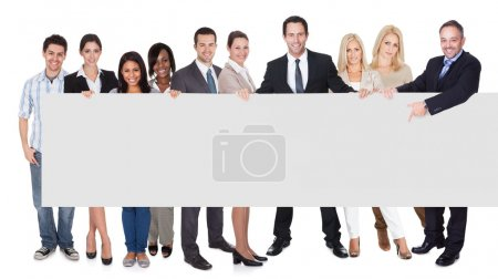 Photo for Group of business presenting empty banner. Isolated on white - Royalty Free Image
