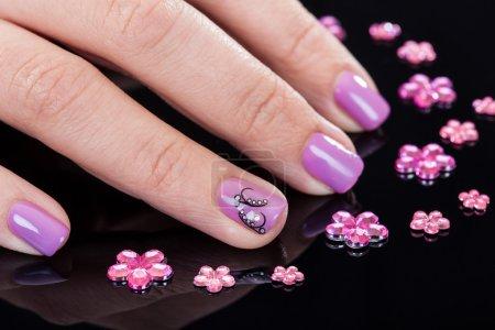 Close-up Of Fingernails And Rhinestones