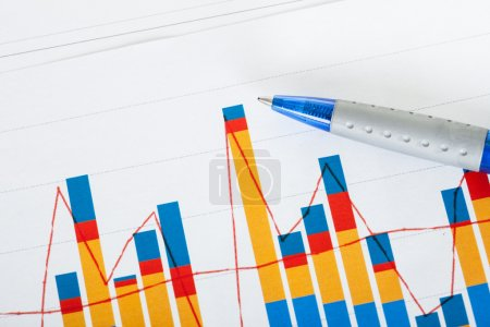 Photo of pen and growth charts