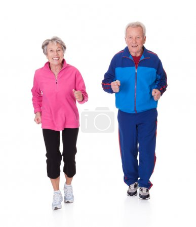 Photo for Portrait Of Senior Couple Jogging Over White Background - Royalty Free Image