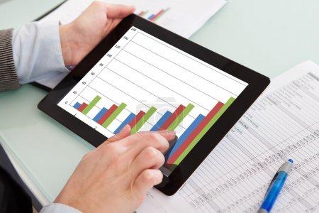 Close-up Of Hands Holding Digital Tablet