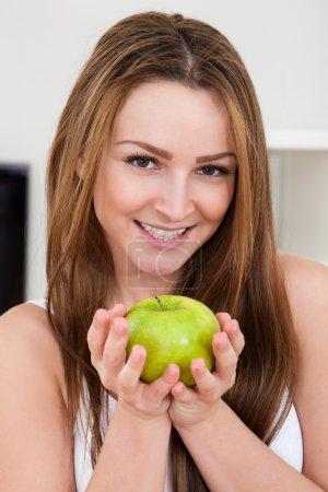 Happy Woman Holding Apple