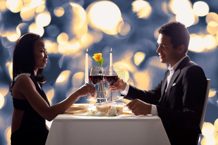 Photo for Portrait Of Romantic Couple Toasting Red Wine At Dinner - Royalty Free Image