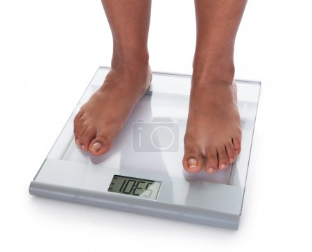 Low Section Of A Young On A Weighing Scale