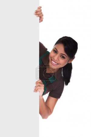 Photo for Young Female Gardner Holding Placard Over White Background - Royalty Free Image
