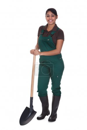 Photo for Young Female Gardner With Shovel Isolated Over White Background - Royalty Free Image