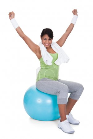 Young Woman Sitting On Pilates Ball