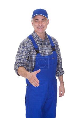 Mature Male Technician Offering Handshake