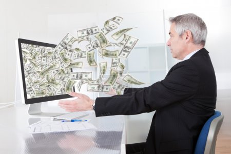 Businessman With Lots Of Cash