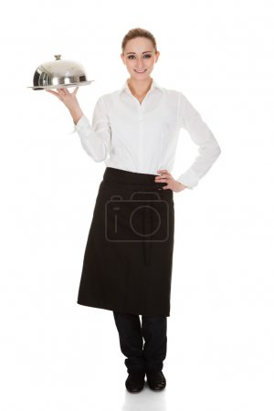 Photo for Happy Young Waitress Holding Tray And Lid Over White Background - Royalty Free Image