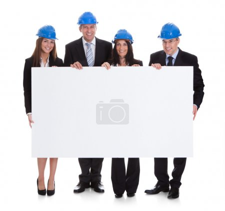 Group Of Architects Holding Placard