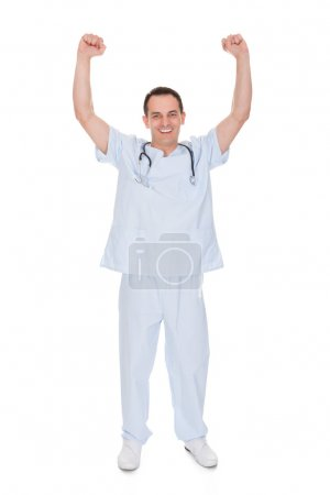Portrait Of Male Doctor With Arm Raised