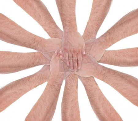 Close-up Of Hands Stacking On Each Other