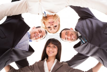 Group Of Businesspeople Putting Heads Together