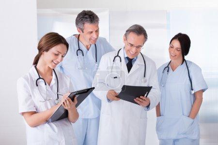 Portrait Of Happy Doctors Working Together
