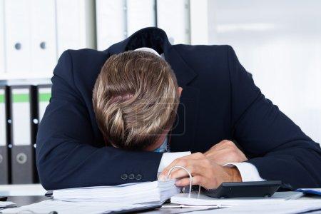 Businessman Sleeping In Office