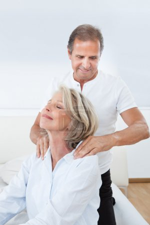 Photo for Mature Man Massaging Woman's Shoulder In Bed - Royalty Free Image