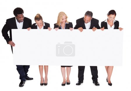 Photo for Group Of Happy Business People With Placard Over White Background - Royalty Free Image