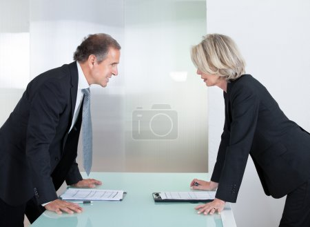 Mature Businessman And Businesswoman Fighting