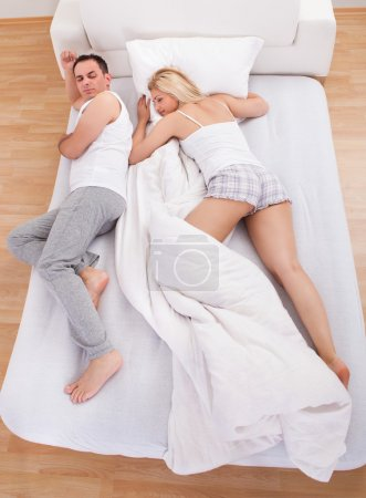 Uncomfortable Husband Sleeping