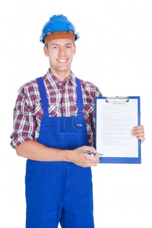 Happy Young Male Worker Holding Contract Form