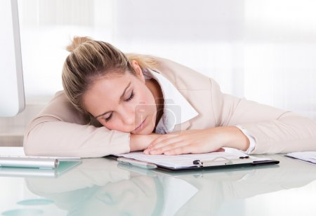 Exhausted Young Businesswoman Sleeping