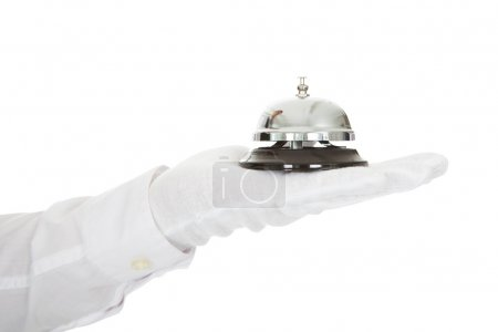 Photo for Waiter In White Gloves Holding A Service Bell Isolated Over White Background - Royalty Free Image