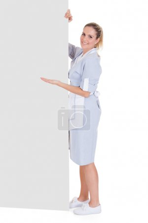 Young Maid Gesturing On Blank Placard