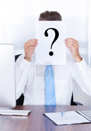 Businessman Holding Question Mark Sign On Paper