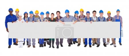 Group Of Construction Workers With Placard