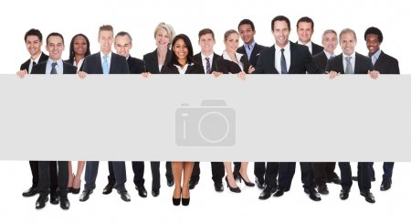 Group Of Businesspeople With Placard