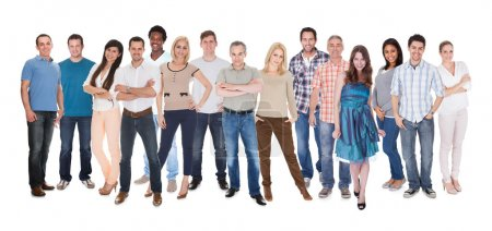 Photo for Happy Group Of People Dressed In Casual Standing Over White Background - Royalty Free Image