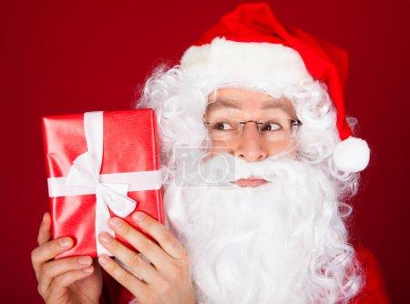 Portrait santa holding gift