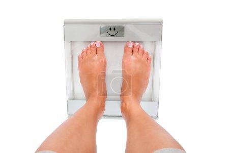 Woman's Feet Measuring Weight