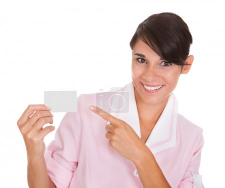 Photo for Young Female Maid Showing Visiting Card Over White Background - Royalty Free Image