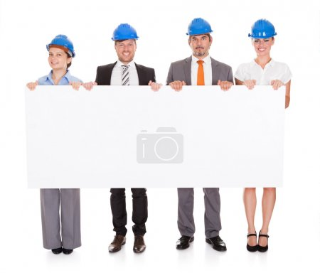 Architects Holding Placard