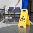 Close-up Of Man Cleaning The Floor With Yellow Wet...