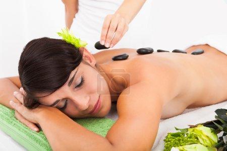 Woman Receiving Lastone Massage