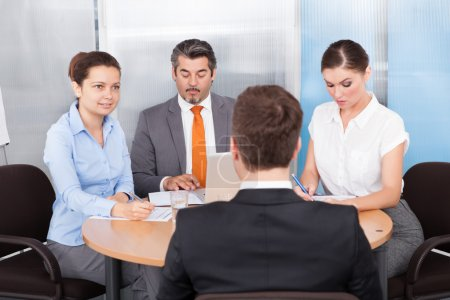Businesspeople Conducting Interview