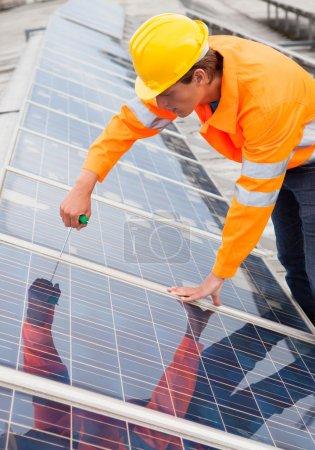 Engineer Adjusting Solar Panels