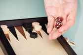 Person Playing Backgammon