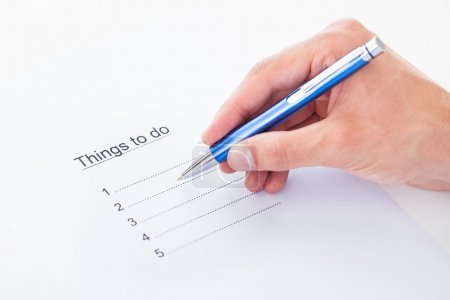 Hand filling things to do list