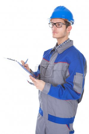 Male Construction Reviewer Holding Pen And Clipboard