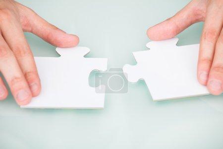Businessman Solving Jigsaw Puzzle