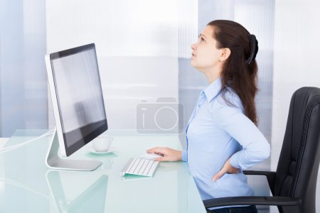 Photo for Portrait Of Young Businesswoman Suffering From Back Pain - Royalty Free Image