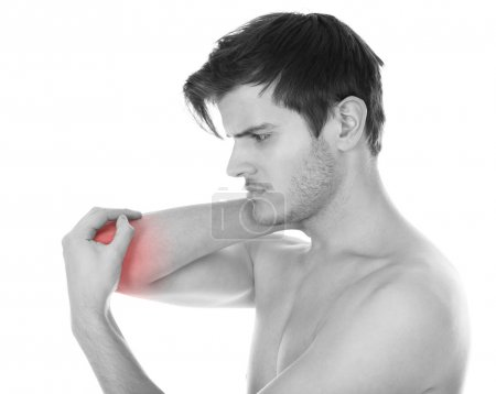 Photo for Shirtless Young Man Suffering From Elbow Pain On White Background - Royalty Free Image